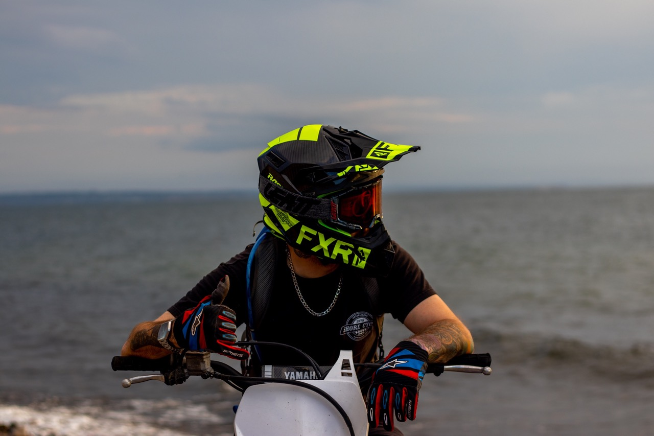dirt bike rider with ocean in background